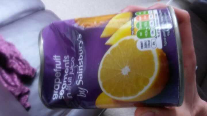 Opened tinned grapefruit segments