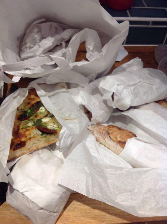 Sausage rolls, filled baguettes, filled vegetarian rolls, one slice veggie focaccia pizza