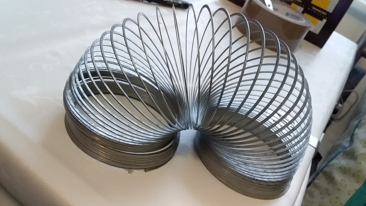 Silver colour slinky toy