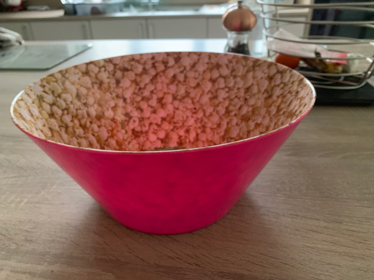 Large pink bowl with popcorn decor inside