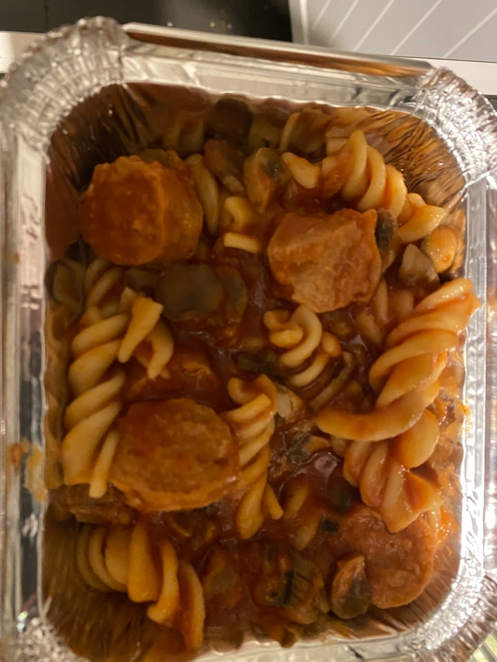 Pasta and sausage with sauce