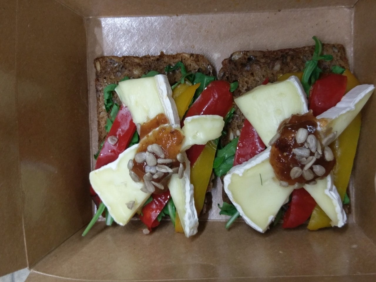 A box of open sandwiches