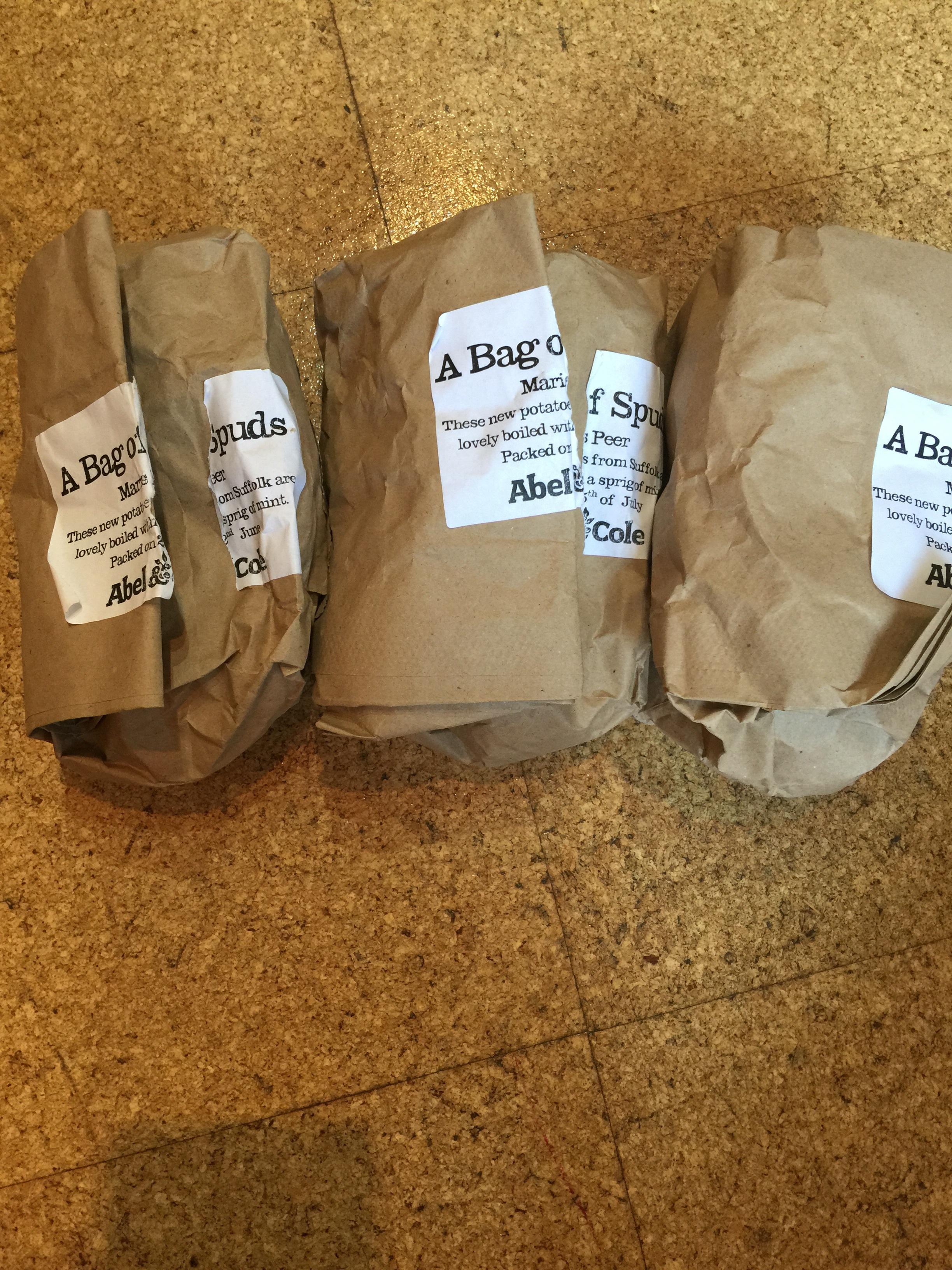 Three bags of organic potatoes
